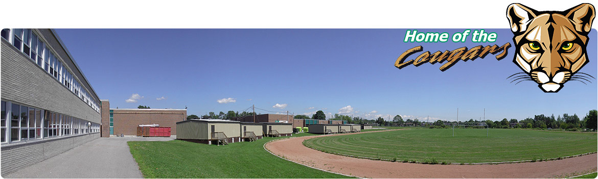"Image of school track and portables. Text in top right hand corner reads ""Home of the Cougars"""